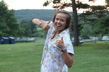 Summer camp counselor thumbs up