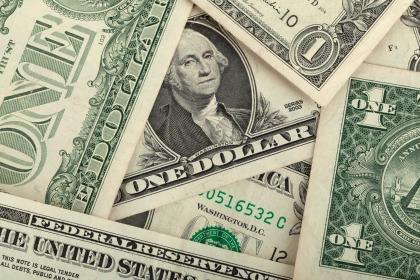 1 dollar bill getting paid at camp