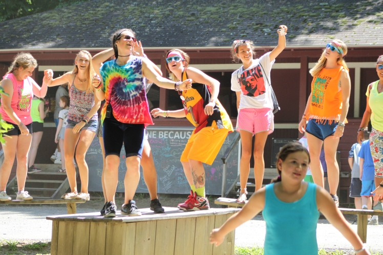 Summer Camp dancing on benches