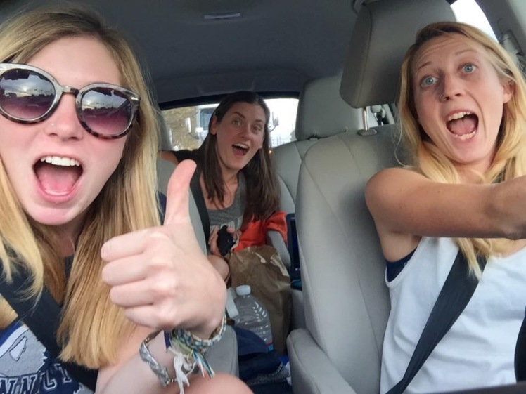 road trip girls car thumbs up