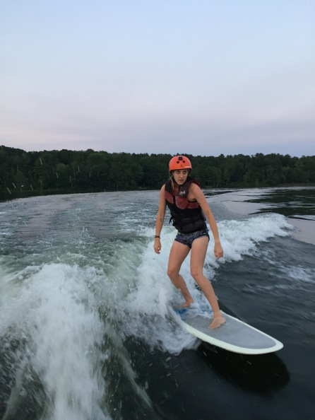 Summer camp counsellor wakesurfing